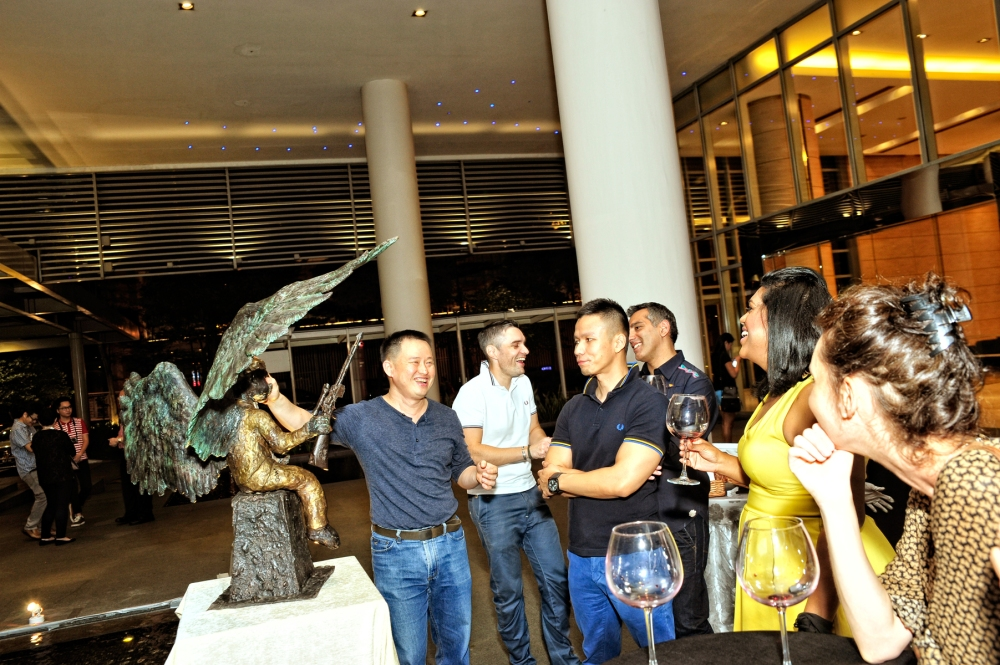 Artist Ch'ng Huck Theng (left) explained the story behind his works to the guests